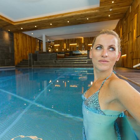 indoor pool woman wellness holiday