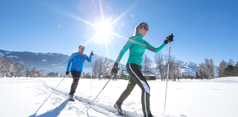 couple cross-country-skiing active holiday salzburger land
